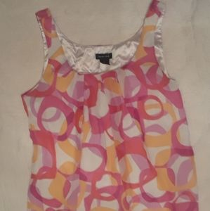 Lady's  colorful sleeveless top.